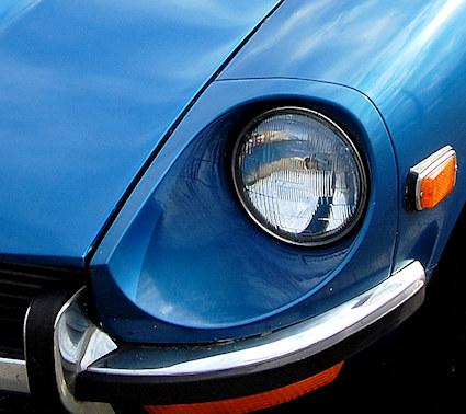 A photo of a Nissan Datsun 240Z Headlight on the front for the car