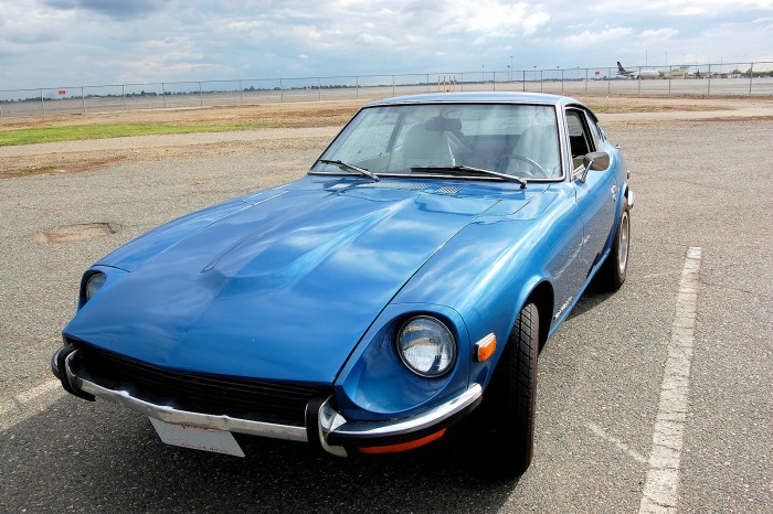 A photo of the front of a Nissan Datsun 240Z with the headlights shown