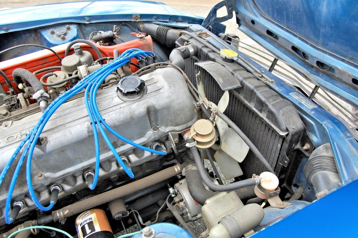 A photo of the Nissan Datsun 240Z Radiator in the engine compartment